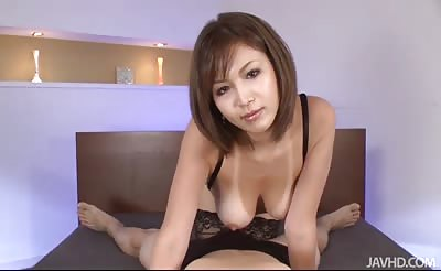 JavHD - Sexy tanned Mai Kuroki in bed playing with a horny guys cock making him cum