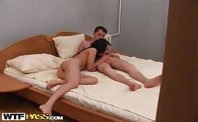 Three naked students have fun in a bedroom