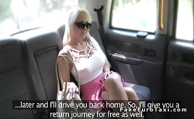 Busty blonde earns free ride in fake taxi
