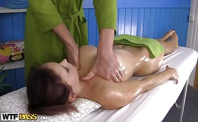 Buxom redhead girl gets a dick in the massage room