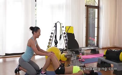Lesbians fitness coach licking pussy