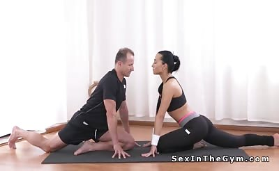 Fit brunette beauty has yoga class and sex