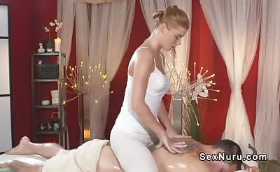 Blonde giving massage with her bare tits