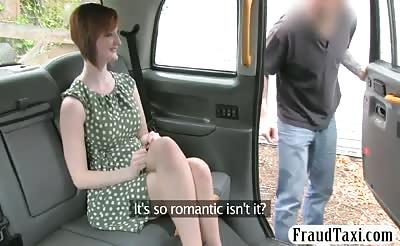 Redhead passenger railed in the taxi to off her fare