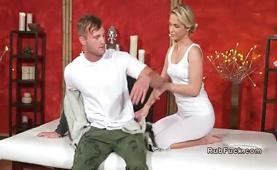 Blonde masseuse gives footjob and fuck