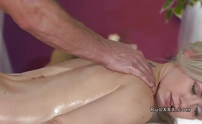 Blonde gets sensual massage from strong masseur