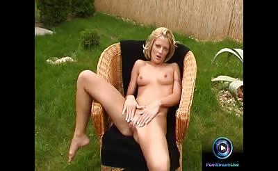 Christel dildoing naked at the garden