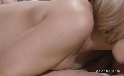 Blonde licks pussy to busty brunette