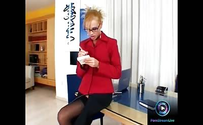 Sandy is in a conference hall fingering her sweet cunt