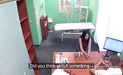 Doctor helps brunette patient gets orgasm