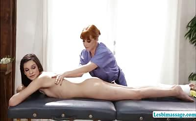 Slutty ladies Penny and Eden have sex on the massage table