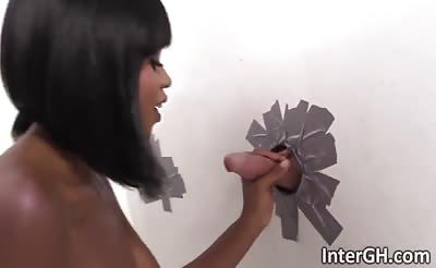 Ebony gets white cock through bathroom glory hole