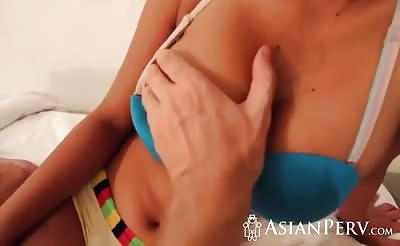 Dude bangs hot busty Asian chick's pussy