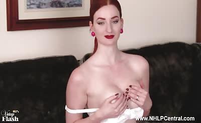 Busty redhead masturbates in sheer vintage nylons