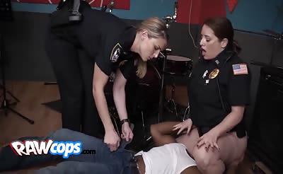 Two busty cops banged by black dude