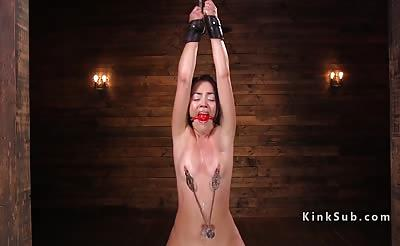 Brunette fingered drooling in bondage
