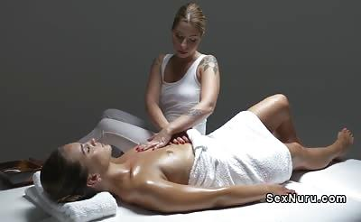 Blonde lesbian masseuse gives cunt massage