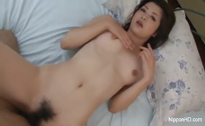 Hairy Asian girl gets a pounding and a facial