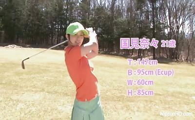 Cute Asian teen girls play a game of strip golf