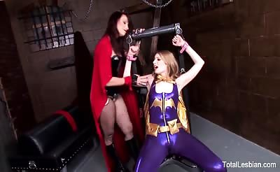 Sexy blonde superhero gets tied up by dominating MILF