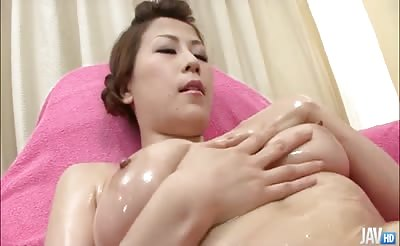 JavHD - Big titty  	Yuki Aida is oiled up at the hospital and left to her own devices she begins to fondle her tits and pussy